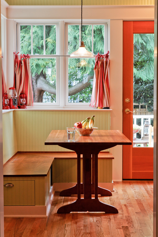 Example of a mid-sized arts and crafts light wood floor dining room design in Seattle