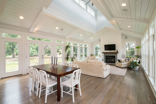 Large country medium tone wood floor dining room photo in Baltimore with white walls