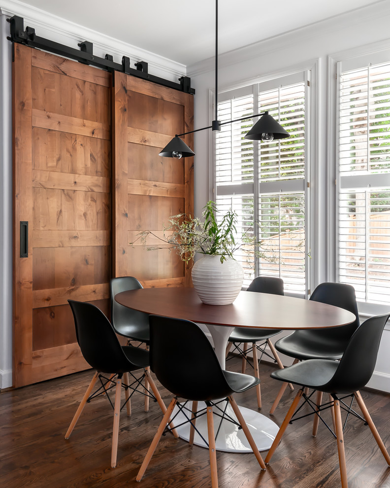 Example of a mid-sized transitional dark wood floor and brown floor kitchen/dining room combo design in Atlanta with white walls