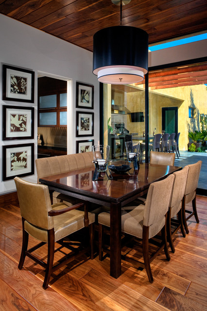 Trendy dining room photo in Las Vegas with white walls