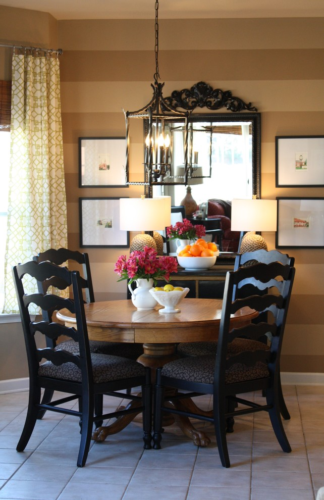 Dining room - contemporary ceramic tile dining room idea in Charlotte with brown walls
