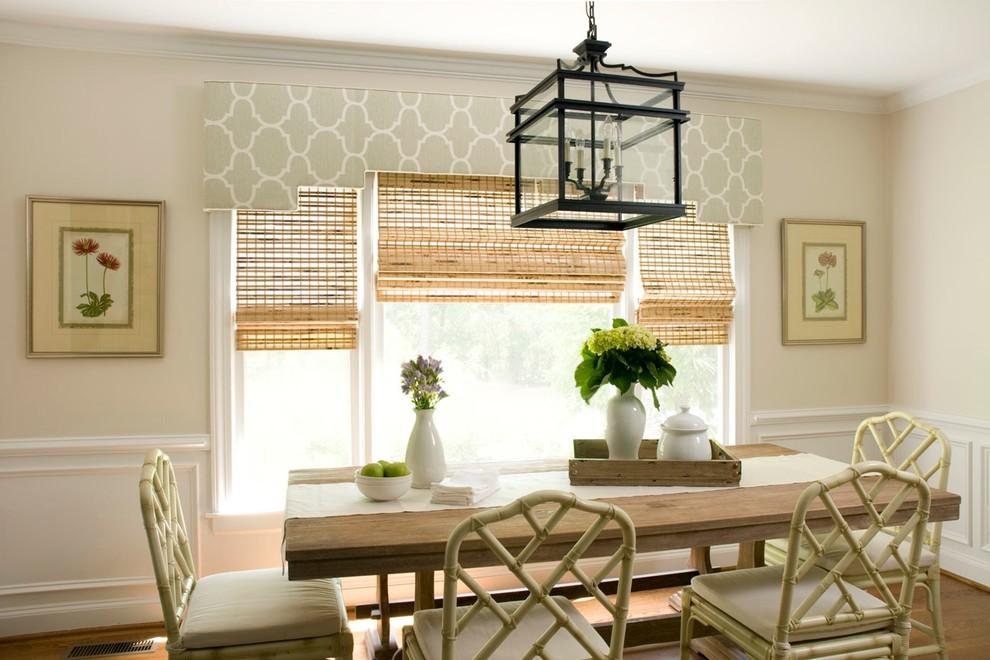 Elegant medium tone wood floor dining room photo in Wilmington with beige walls