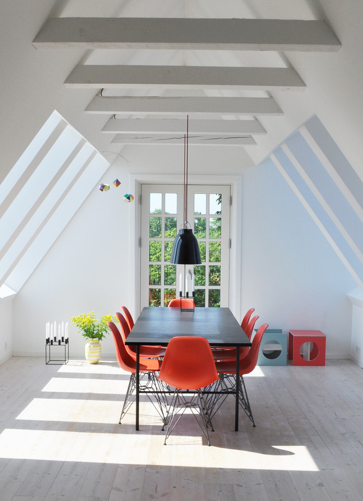 Mid-sized danish light wood floor enclosed dining room photo in Copenhagen with white walls