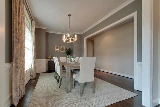 Mid-sized 1950s dark wood floor and brown floor dining room photo in Nashville with gray walls