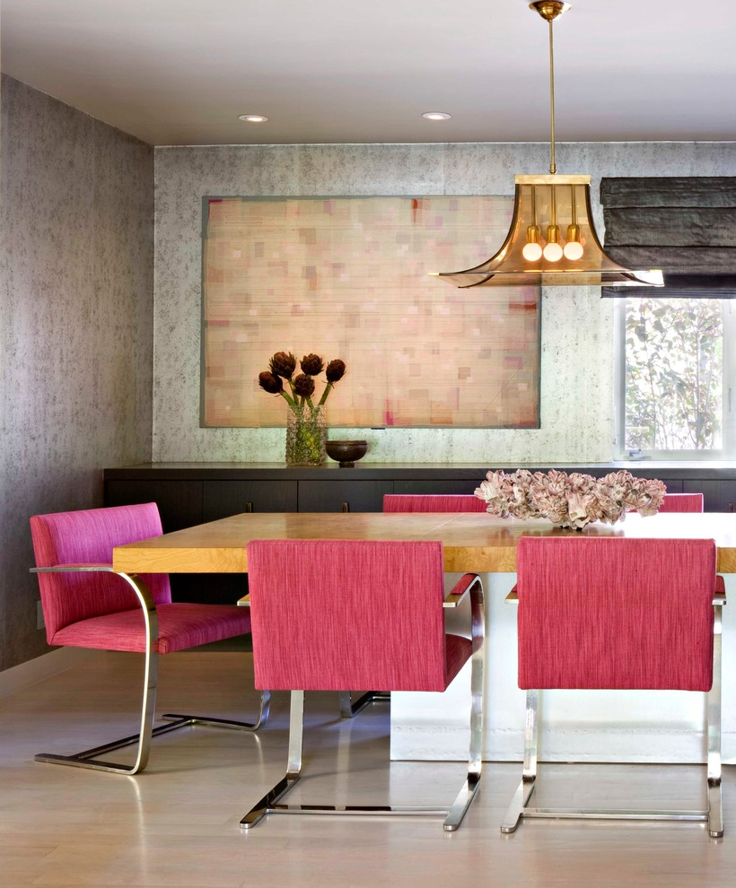 Inspiration for a mid-century modern light wood floor dining room remodel in Los Angeles with metallic walls