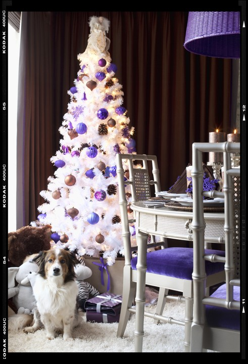 or you can really jazz it up and pair the purple with a gold tree via daily mail