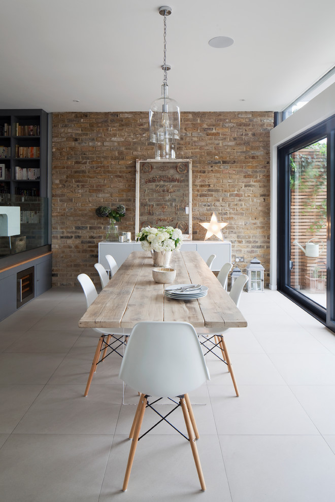 Example of a large country porcelain floor and gray floor great room design in London with white walls