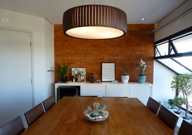 Large trendy porcelain floor and gray floor kitchen/dining room combo photo in Other with gray walls