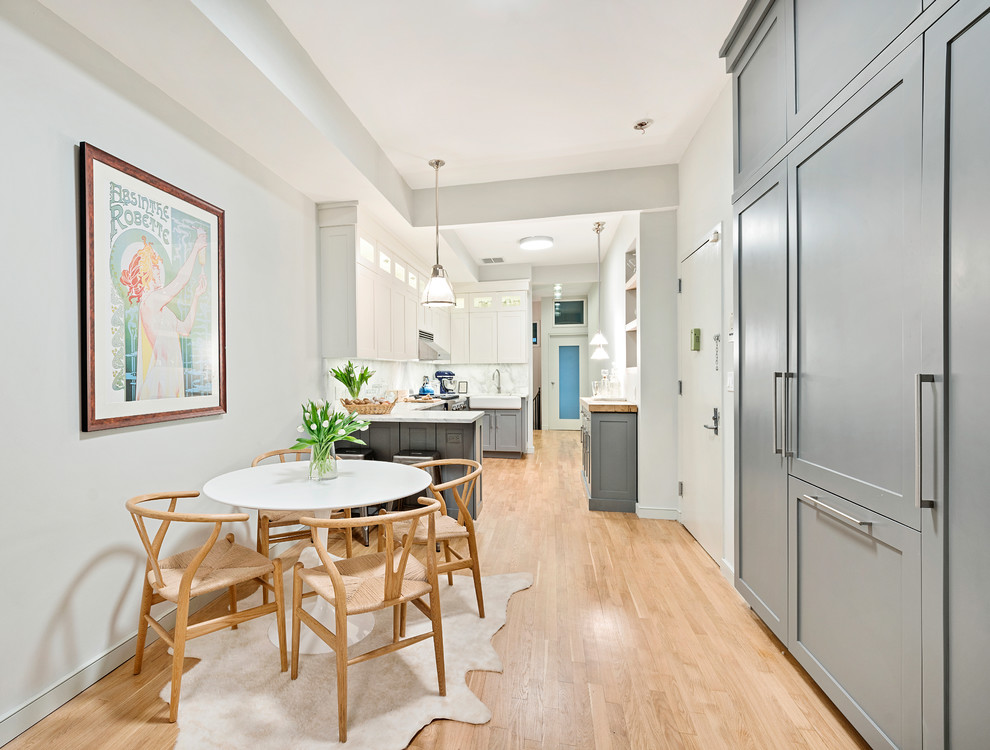 Example of a mid-sized danish kitchen/dining room combo design in New York with gray walls