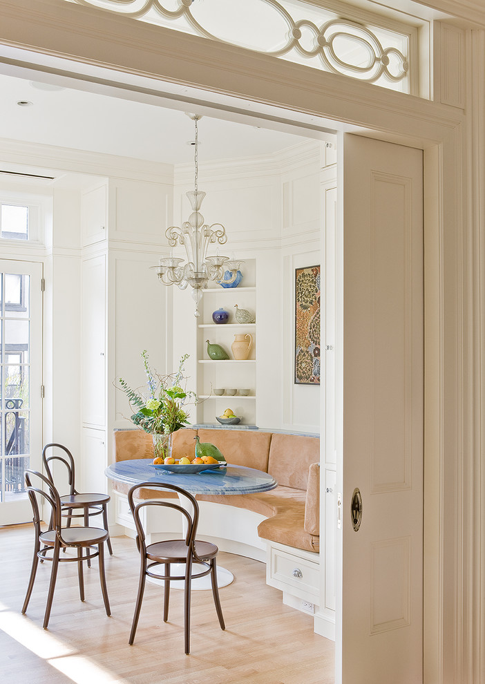 Dining room - traditional light wood floor dining room idea in New York with white walls