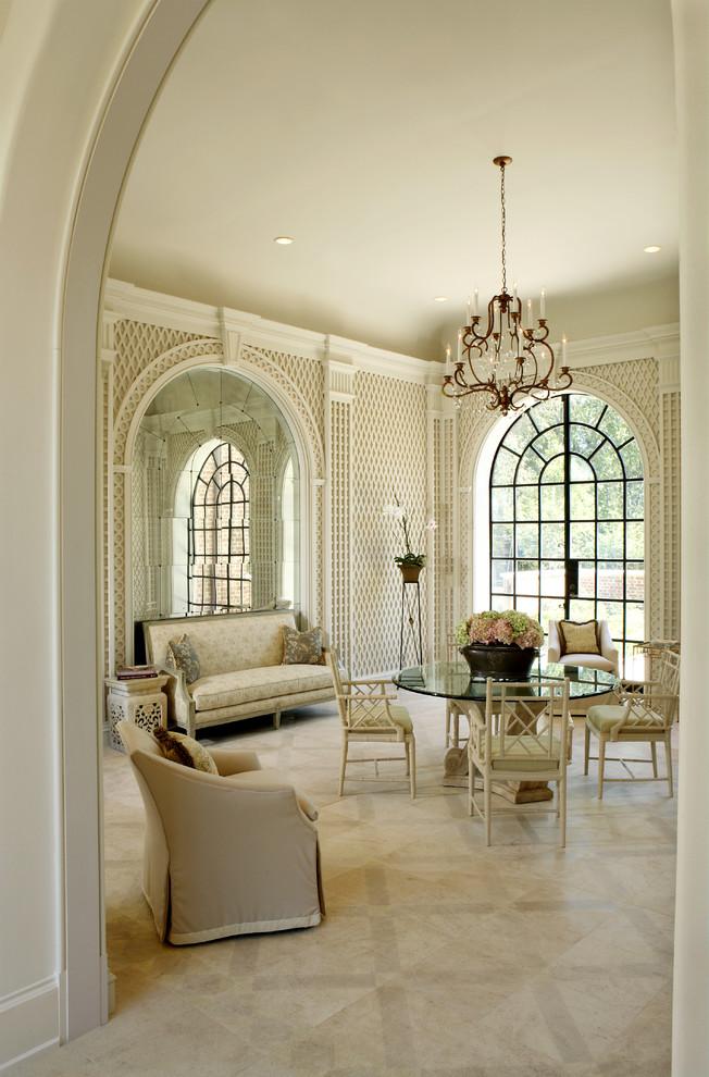 Ornate marble floor enclosed dining room photo in Atlanta with beige walls