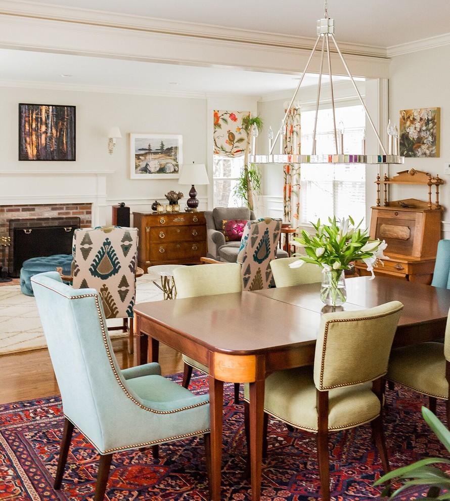 Elegant medium tone wood floor dining room photo in Boston
