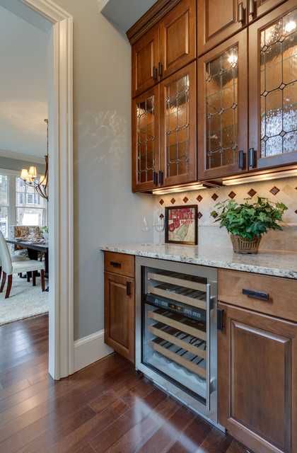 Butler S Pantry With Lighted Glass Cabinets Traditional