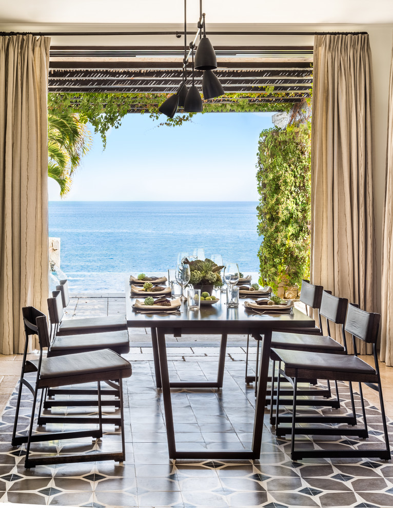 Inspiration for a mediterranean dining room remodel in San Francisco with beige walls
