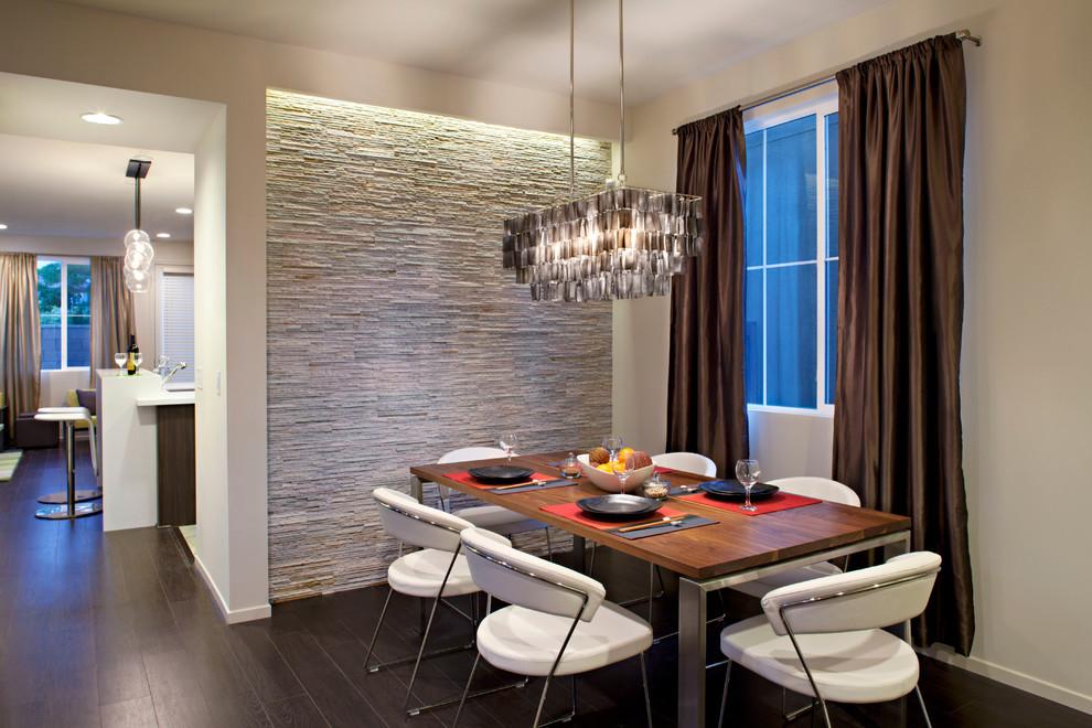 Example of a trendy dark wood floor dining room design in Los Angeles