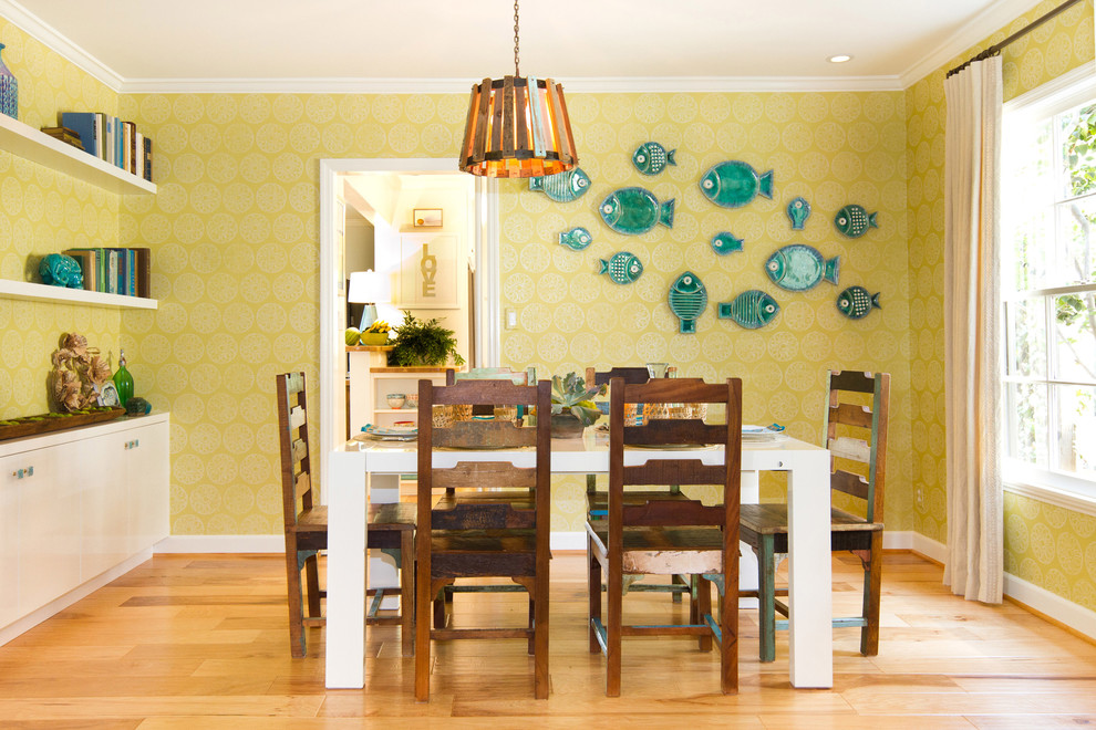 Example of a beach style light wood floor enclosed dining room design in Los Angeles with green walls