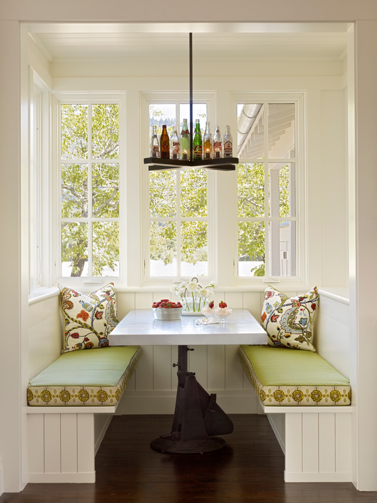 Example of a farmhouse dark wood floor dining room design in San Francisco with white walls