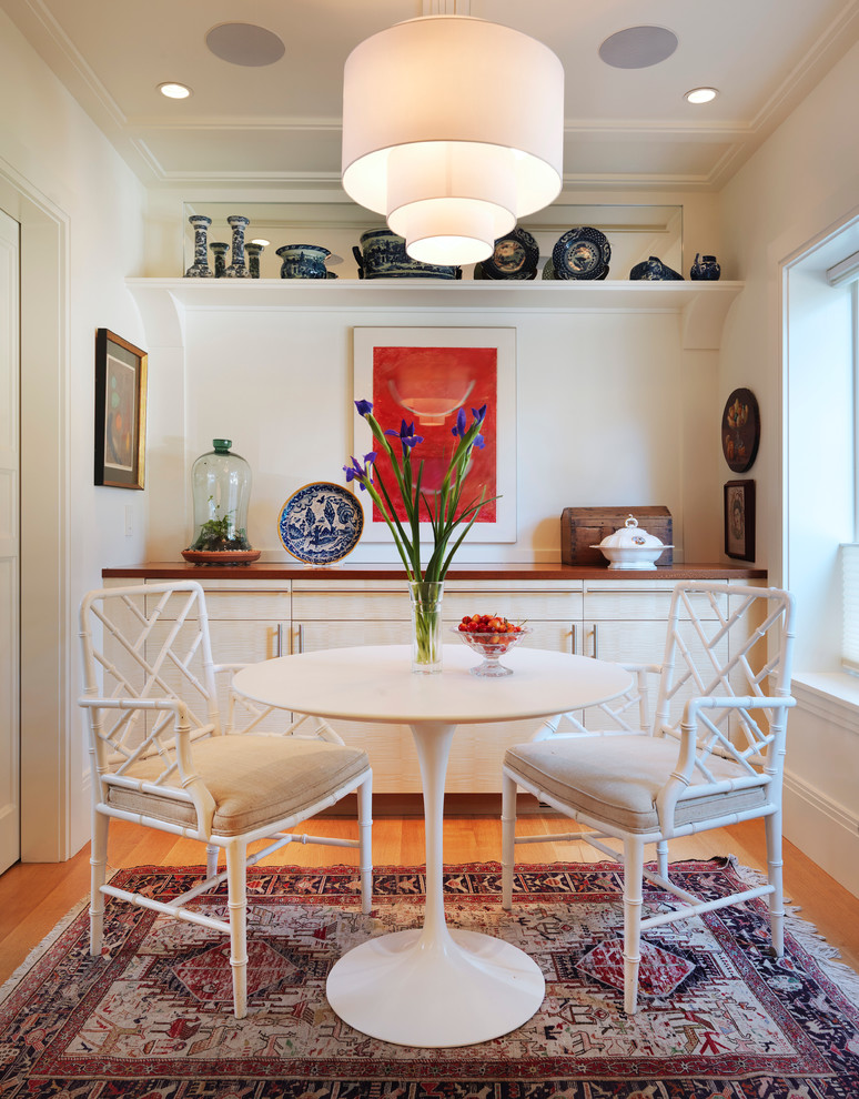 Dining room - transitional medium tone wood floor dining room idea in Boston with white walls