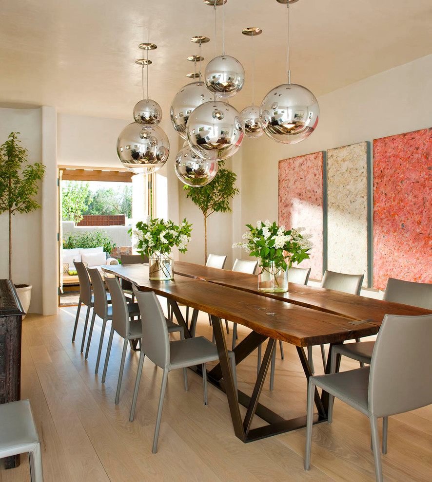 Inspiration for a southwestern medium tone wood floor kitchen/dining room combo remodel in Albuquerque with white walls
