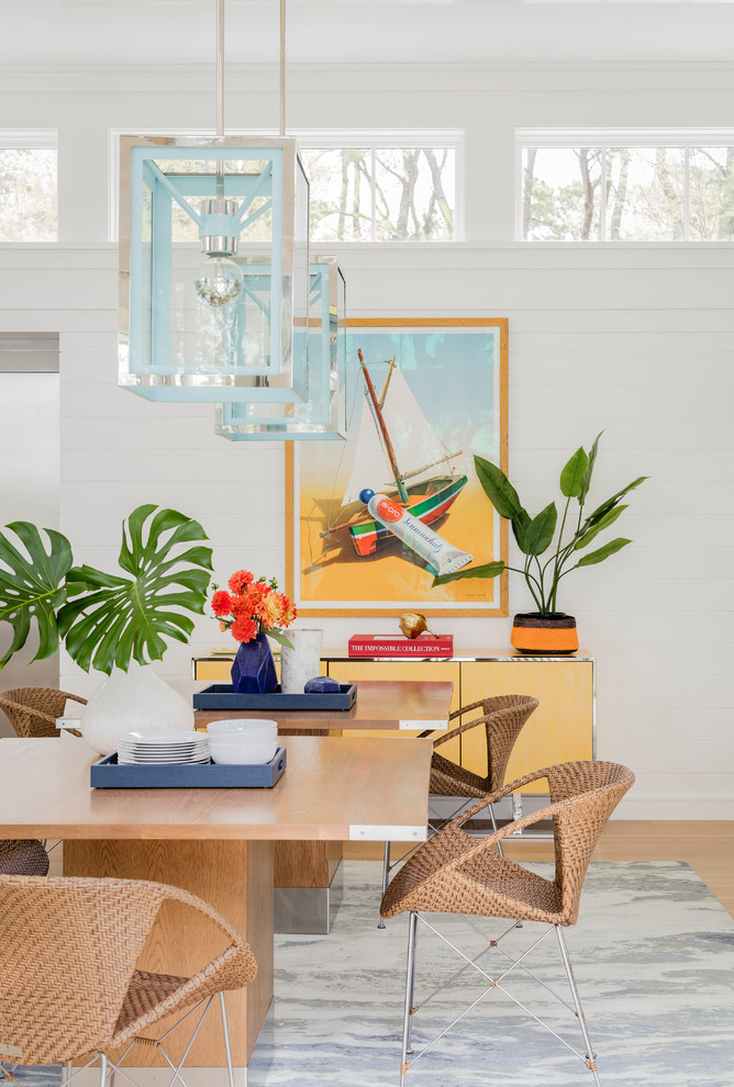 Inspiration for a coastal medium tone wood floor and brown floor dining room remodel in Boston with white walls