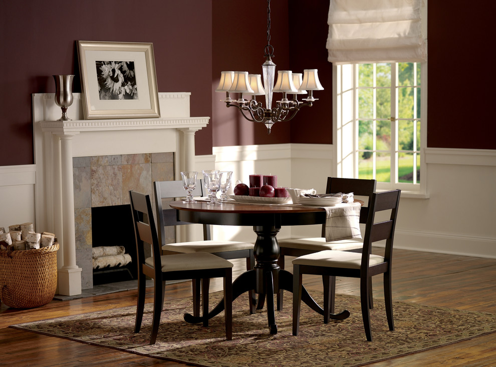 Dining room - traditional dark wood floor dining room idea in New York with red walls and a standard fireplace