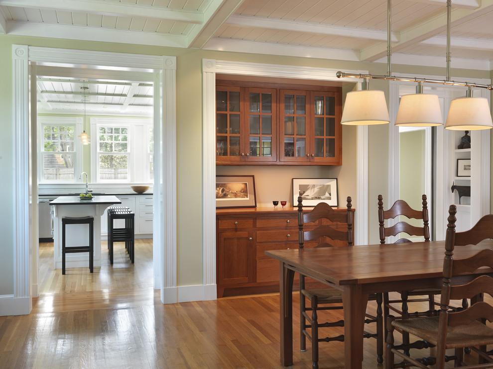 Elegant dark wood floor dining room photo in Providence with beige walls