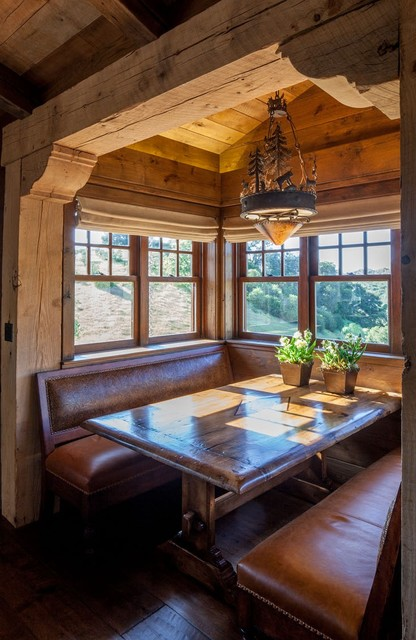 Example of a mid-sized mountain style dark wood floor and brown floor great room design in Denver with brown walls and no fireplace