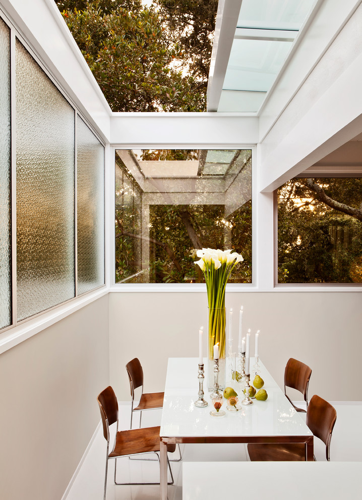Dining room - mid-century modern dining room idea in San Francisco with beige walls