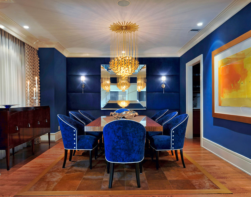 Inspiration for a mid-sized contemporary brown floor and medium tone wood floor enclosed dining room remodel in New York with blue walls and no fireplace