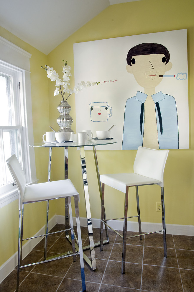 Eclectic ceramic tile dining room photo in Louisville with yellow walls