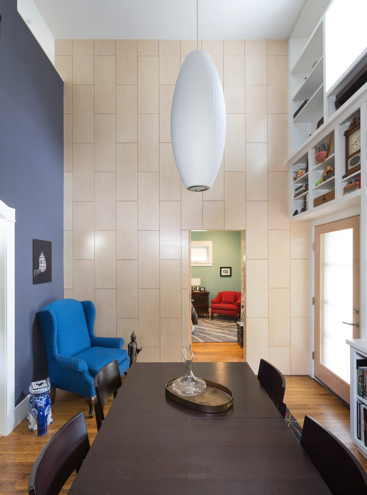 Inspiration for a small contemporary medium tone wood floor enclosed dining room remodel in Austin with blue walls