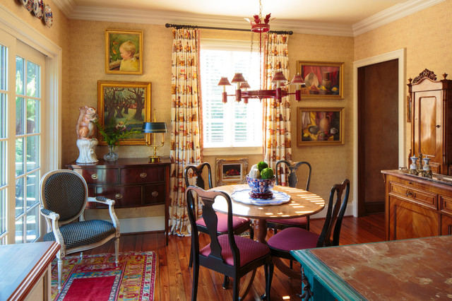 Example Of An Ornate Dark Wood Floor Enclosed Dining Room Design In Other With Yellow Walls
