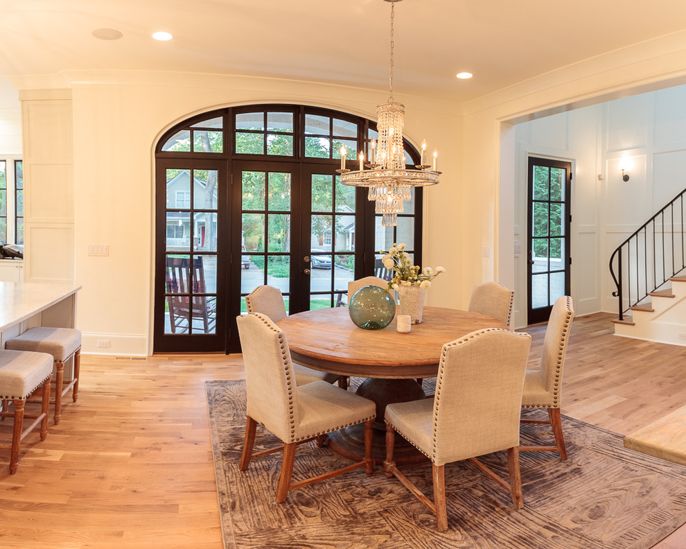 Large transitional light wood floor kitchen/dining room combo photo in Charlotte with white walls