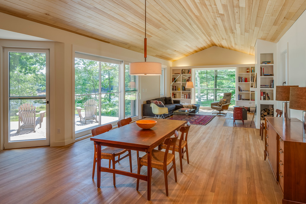 Inspiration for a cottage medium tone wood floor great room remodel in Portland Maine