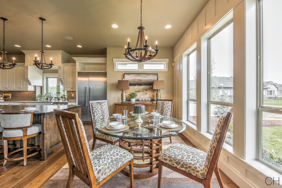 Example of a mid-sized trendy dark wood floor and brown floor kitchen/dining room combo design in Orange County with beige walls and no fireplace