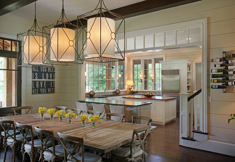 Mountain style dark wood floor and brown floor kitchen/dining room combo photo in Atlanta