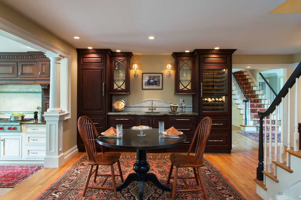 Inspiration for a mid-sized timeless light wood floor kitchen/dining room combo remodel in Boston with beige walls and no fireplace