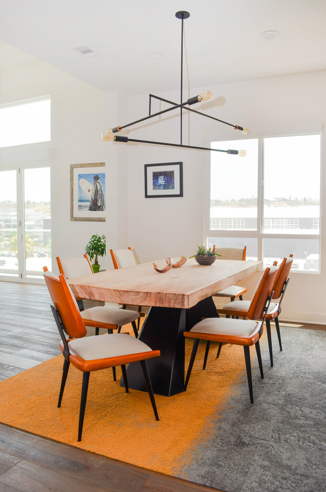 Inspiration for a large 1960s medium tone wood floor and gray floor great room remodel in Los Angeles with white walls and no fireplace