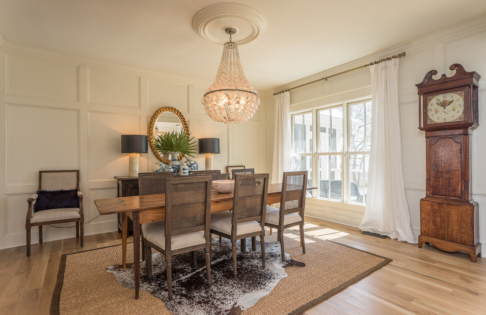 Transitional light wood floor and beige floor dining room photo in Charleston with white walls