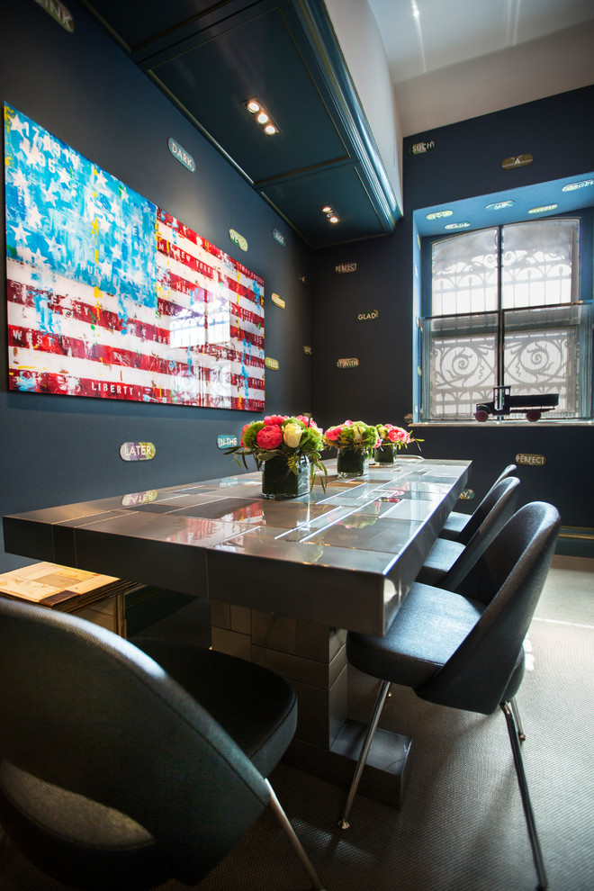 Trendy dining room photo in New York with black walls