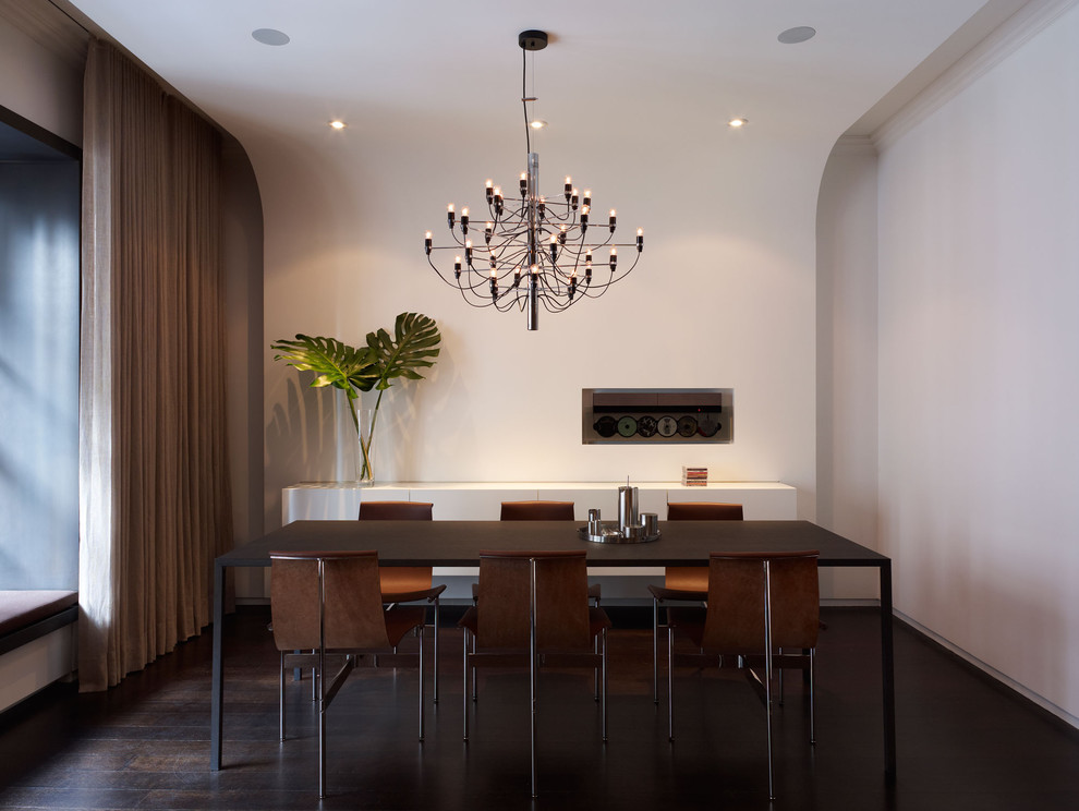 Minimalist dark wood floor dining room photo in New York with white walls