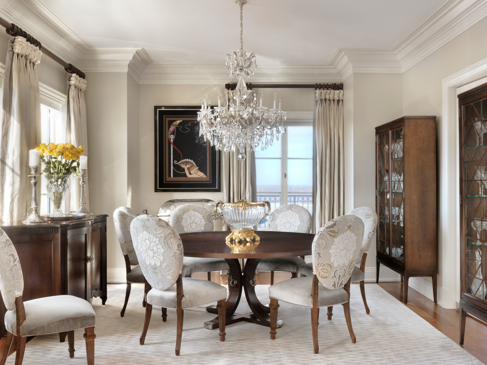 Mid-sized elegant medium tone wood floor and brown floor enclosed dining room photo in Other with gray walls and no fireplace
