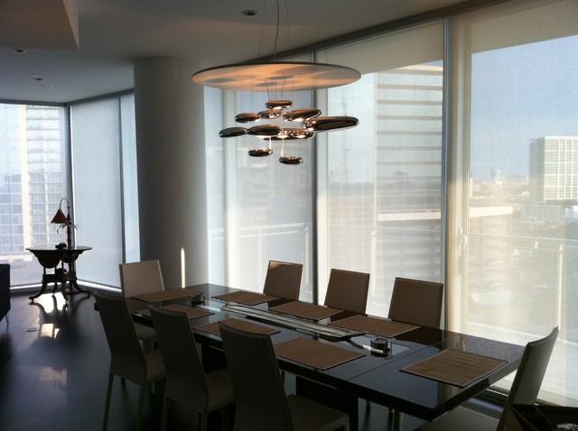 chandelier installation by quatro team modern dining