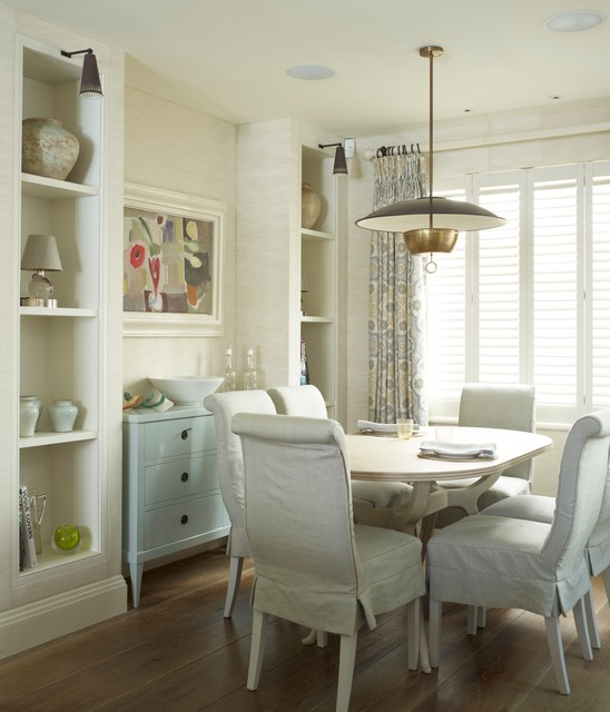 Design ideas for a traditional dining room in London with white walls and medium hardwood flooring.