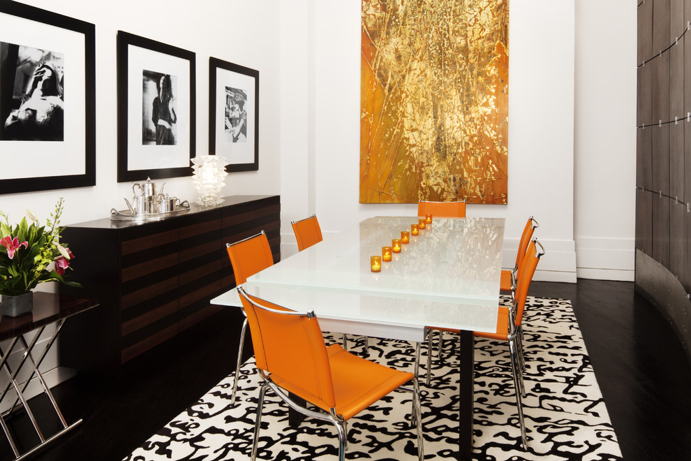 Inspiration for a modern dark wood floor dining room remodel in New York with white walls