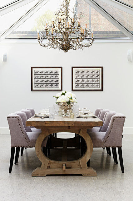 Design ideas for a traditional dining room in London with white walls and no fireplace.