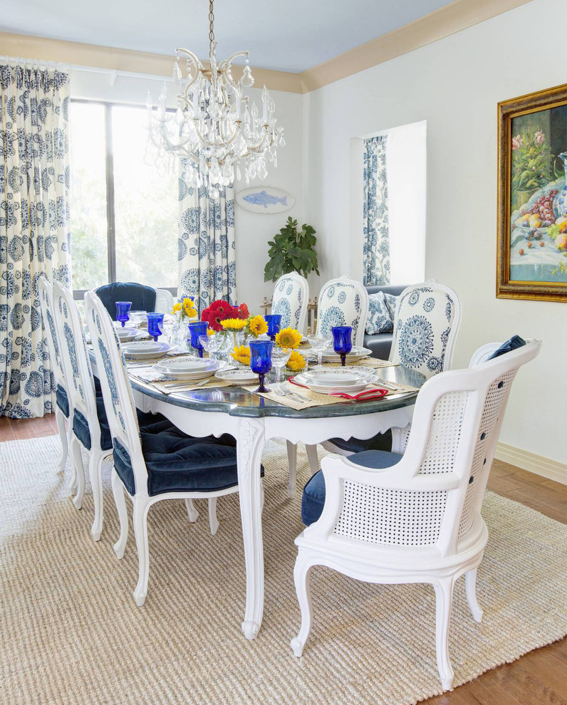 Mid-sized elegant medium tone wood floor enclosed dining room photo in San Francisco with white walls
