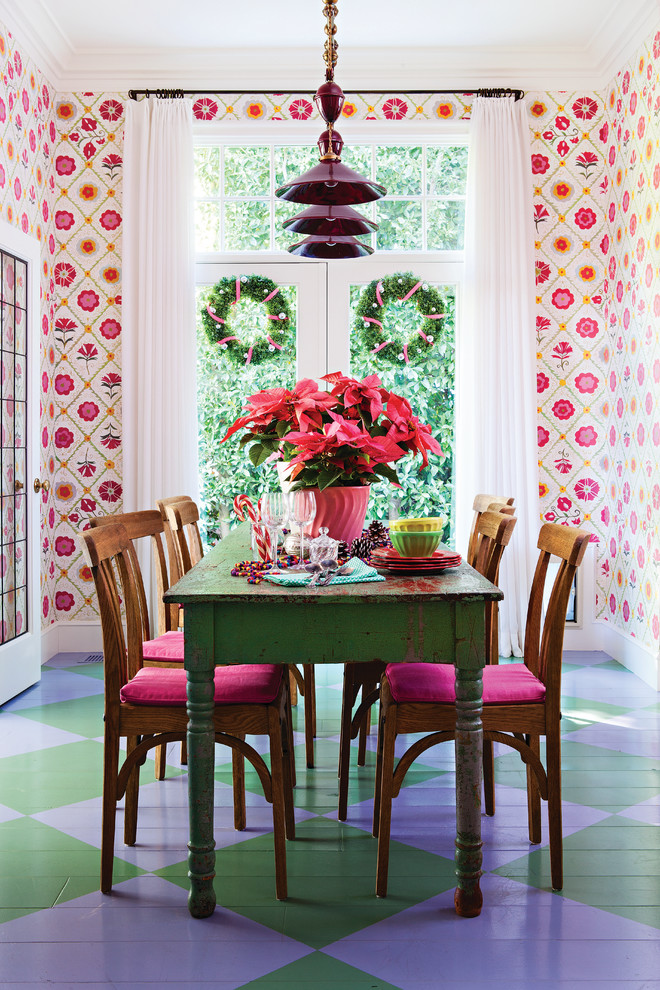 Eclectic painted wood floor and multicolored floor enclosed dining room photo in Los Angeles with multicolored walls