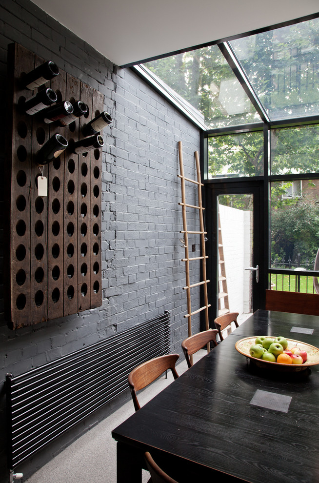 Inspiration for a contemporary dining room remodel in London with gray walls