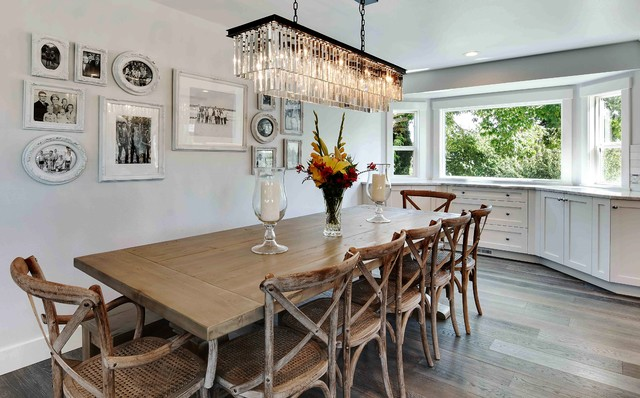Example of a mid-sized transitional medium tone wood floor kitchen/dining room combo design in Seattle with white walls